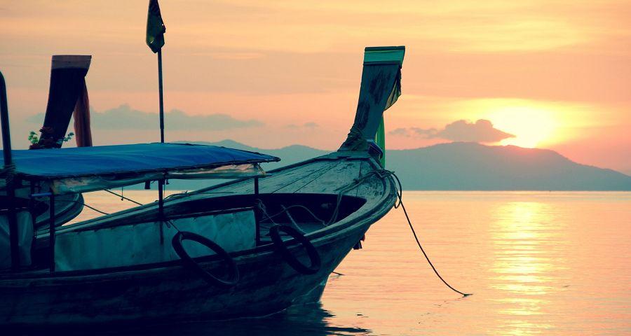 Coastal scene at sundown with boat