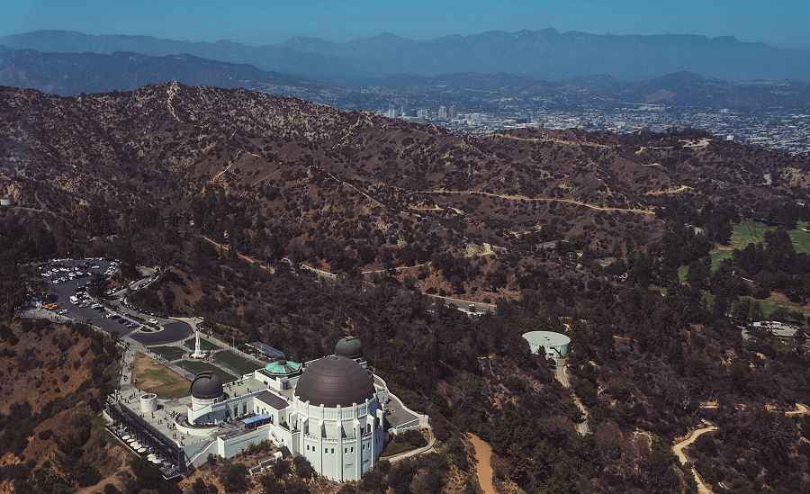 Aerial view of Griffith Park Obervatory with Los Angeles in background