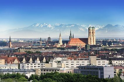 Munich city view with snow capped mountains in the background.