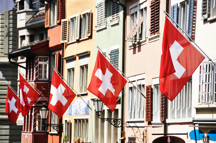 Zurich buildings with Swiss flags