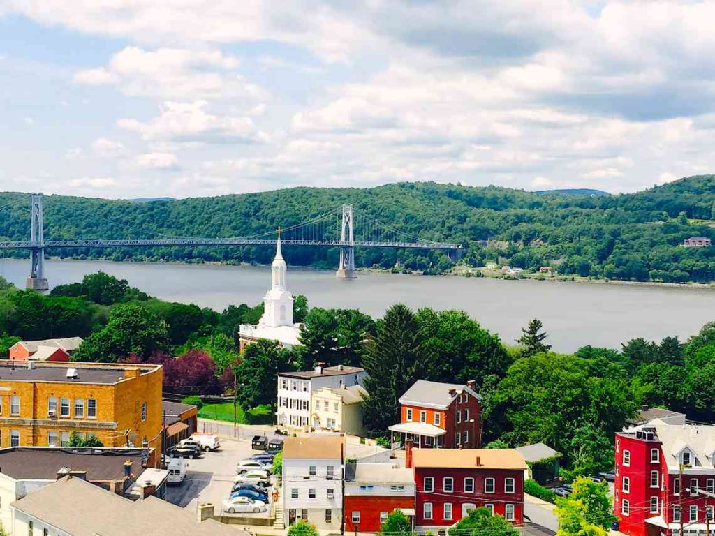Houses and a church in Hyde Park, NY, on the Hudson River.